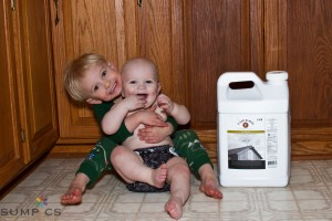"My boys acting as ""Product Models"" to show you the size of a jug of our Olive Oil!  Aren't they cute?"