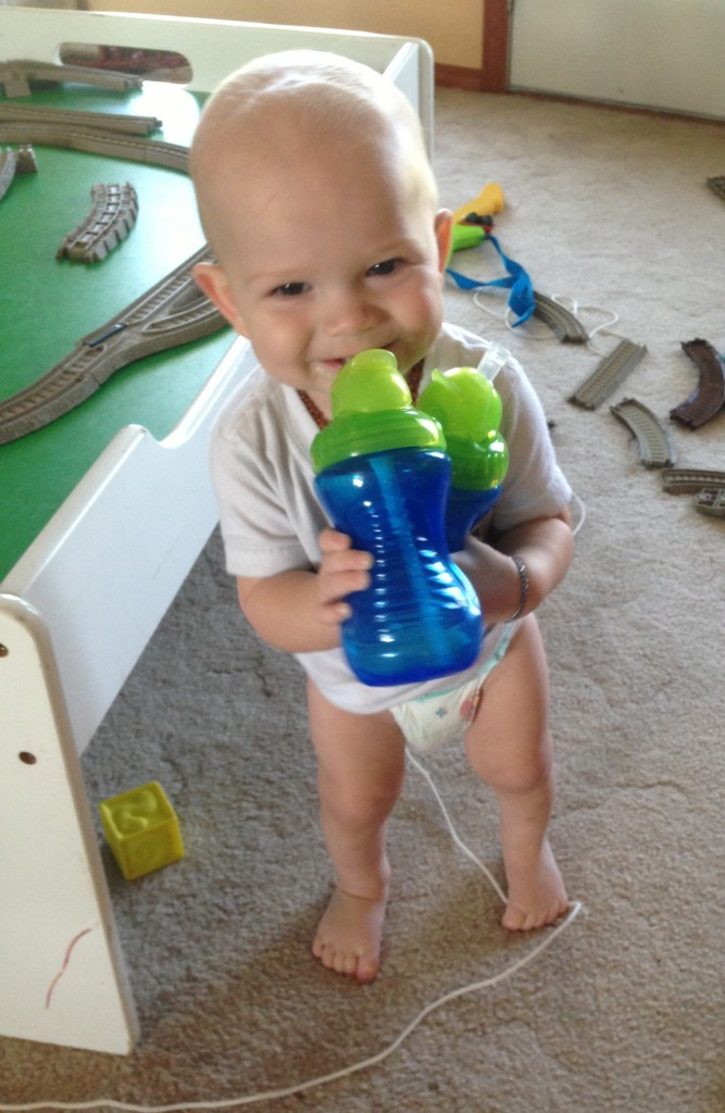 Two-fisted drinker! One sippy of Ali RTF and one of safe water. Too cute!