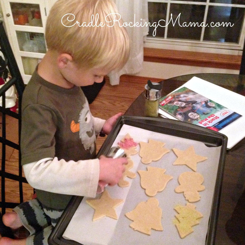 Jed decorating his sugar cookies CradleRockingMama.com